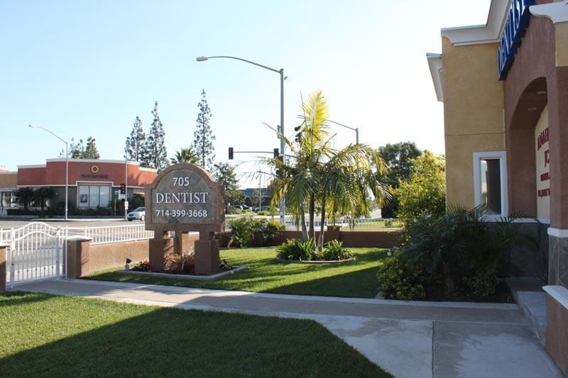 The view of the street and front lawn of our dental office